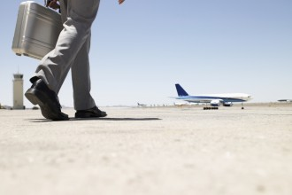 business man walking toward airplane
