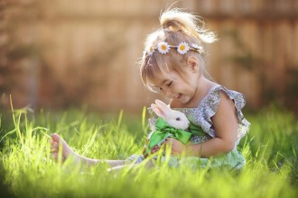 little girl with a bunny rabbit has a easter