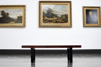 Bench and Paintings in Art Gallery